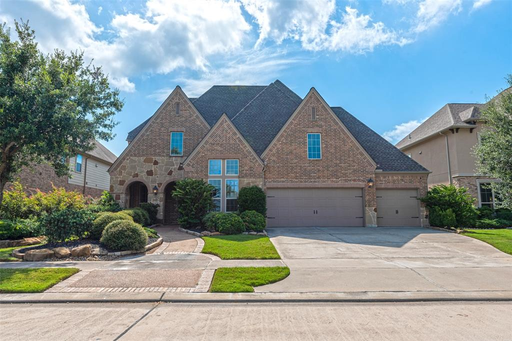 This unique 4,198 sq.foot, former Highland model home is up for grabs in the highly desired Aliana Master Planned Community.  With lakefront view, and a brand new roof, this 5 bedroom home has 4 full bathrooms and 2 half baths. The 10,400 square foot lot has no front neighbors, as it sits across from the community walking trail.  It has an open concept floor plan, game room, study with custom built-ins, and a study nook on the second level.  Each of the three bedrooms upstairs has it's own ensuite bathroom and walk-in closet.  The impressive media room has a separate snack bar, projector, screen and 5.1 surround sound system. Outside, there's a putting green in the backyard, extended covered patio and 4-car tandem garage, complete with hanging storage shelves.  Aliana students are zoned to some of the highest rated schools within the Fort Bend Independent School District.  Residents are minutes from Westpark Tollway, and developing commercial areas with retail and restaurants.