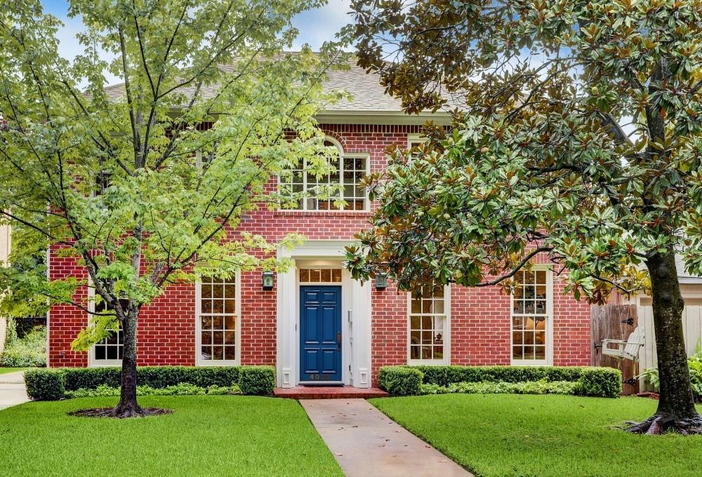This beautifully updated home is less than two blocks from Colonial Park and pool. Gorgeous hardwood and porcelain tile flooring, and custom window treatments throughout. The entry opens to built-in bookshelves at the foyer and a custom seagrass runner on the red oak stairway. The granite and stainless kitchen has subway tile backsplash, Bosch cooktop and large walk-in pantry. Herringbone marble fireplace surround in the den and wine bar with quartz counter and floating wood shelving. Spacious secondary bedrooms have hardwood flooring and share a built-in homework or office space. The large master suite has raised ceilings, three closets, and a completely renovated master bath with quartz double vanity, a sleek freestanding soaking tub, and frameless glass shower. The front yard is punctuated by a large magnolia tree, landscape design is by Lanson B. Jones, and the backyard patio includes a MHP gas grill for evening barbecues.
