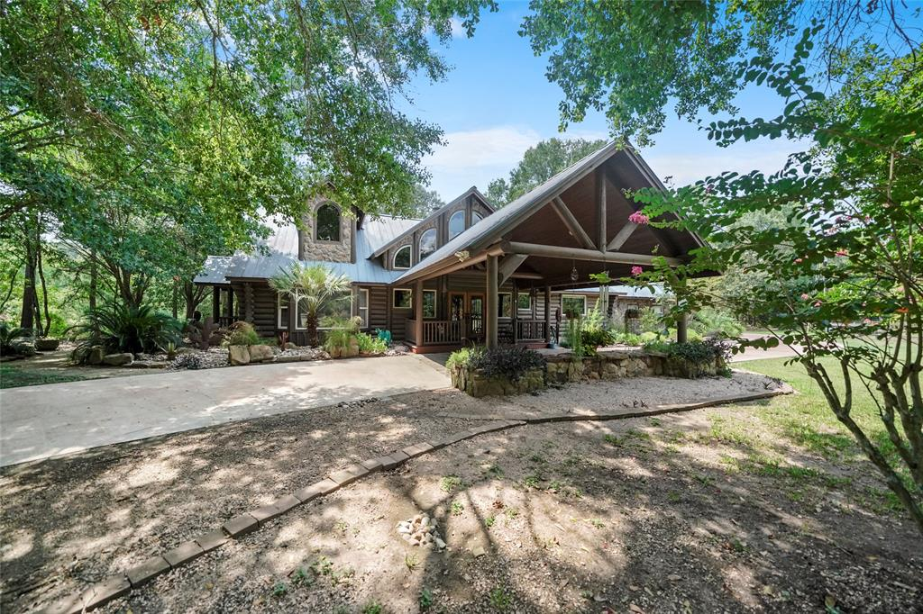 Private Horse Property, truly one of a kind! This Custom Log Home offers 3 Spacious Bedrooms, 1 office or additional bedroom, 2 ½ Bathrooms & a loft upstairs. The home sits on over 16+ acres with a transferable Wildlife exemption located in Hockley, TX! Home was remodeled in 2015, including: Granite counters & copper sink in the kitchen, Professional KitchenAid® range with 2 Convection/Steam Ovens, 6 Burners and griddle, new cabinets, double-sided fireplace, door to patio from master bedroom, large utility room w/a stainless steel sink, Generac® Propane backup generator, solid wood doors & baseboards. Outdoor Features: 6 Stall BarnMaster® Barn w/a bathroom, wash rack, tack room, feed room & lounge, 4 Stall shed row barn, 6 Pastures - 5 w/run in sheds. Sandy loam, 4500 ft. + no climb wire, a 20x40 dressage area, water views & riding trails. A 30x40 Hay Barn w/trailer parking, concrete floors, 16 ft. Eve, 12 ft. sliding doors and 30x12 Covered Dog Kennel. NEVER FLOODED! Truly a Must See!
