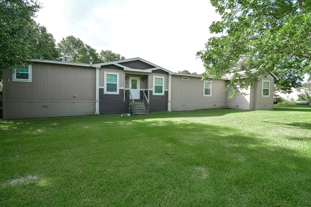 Welcome to 1023 Woodward CR 264 U! This Oak Crest triple wide manufactured home is nested on a LARGE corner lot with trees.   This home offers 4 bedrooms, with 2 bathrooms.  Check out the large gourmet kitchen with sleek black appliances ready for your cooking or baking needs just in time for fall!  Retreat to the covered patio after a long day! Don't delay, and schedule your showing today!