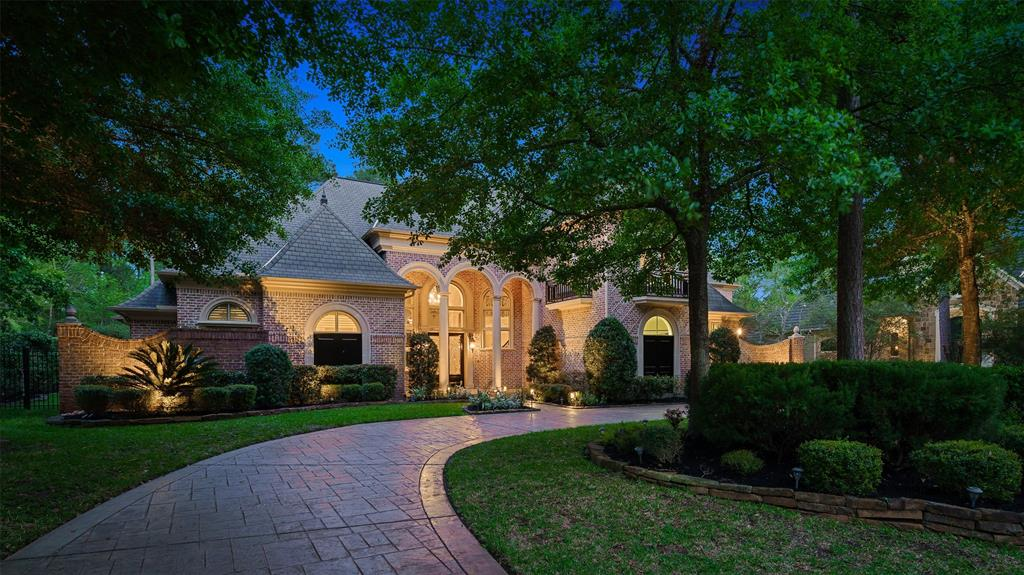 French style masterpiece nestled on an exceptional private lot in Carlton Woods.  This Sterling Classic home stately exterior and luscious backyard dazzles with an inviting and classy pool. Soaring entry welcomes you to formal  2-story living & formal dining centered by a gorgeous wrought iron spiral staircase.  Kitchen is a chef's delight with 2 large islands, exposed beams, Thermador appliances, desk area & and plenty of storage & space to entertain. Kitchen opens to a large & bright family area and great views to the backyard.  1st floor main bedroom with sitting area & his and hers master closets and private guest bedroom down w/en-suite. Spacious 3 secondary bedrooms upstairs with en-suite, game room & flex/media room.  Elevator shaft, 2 staircases, plantation shutters, wood & travertine flooring and circular driveway complete this amazing property. Enjoy panoramic views of the beautiful grounds from every wing of this home & an amazing backyard with a resort-like feel.
