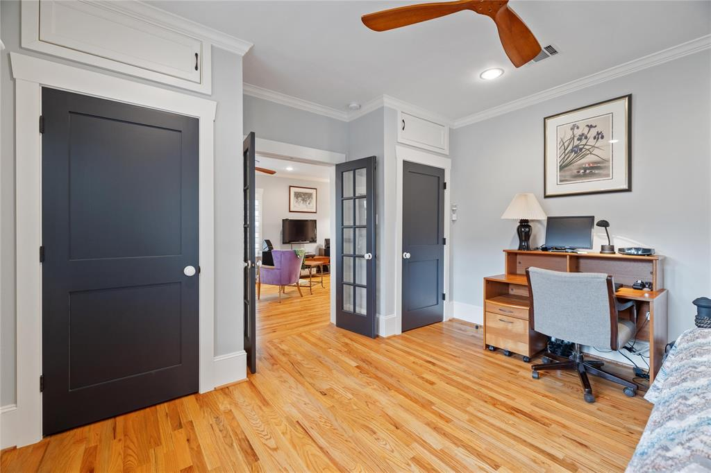 The secondary bedroom has good closet space, crown molding and recessed lights.