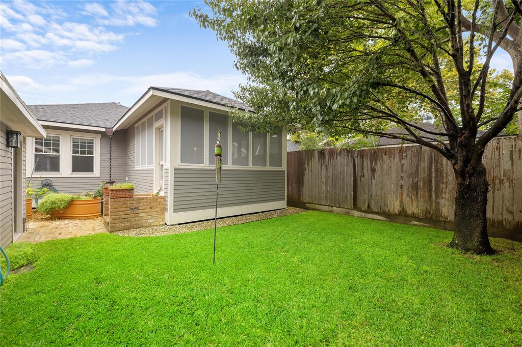 The fully fenced back yard is great for pets and BBQs.