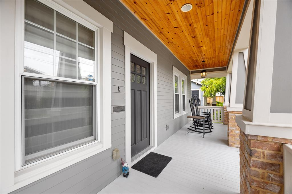 The classic bungalow front porch is a great place to enjoy your morning coffee.  Another great feature are the replacement double pane, double hung windows.