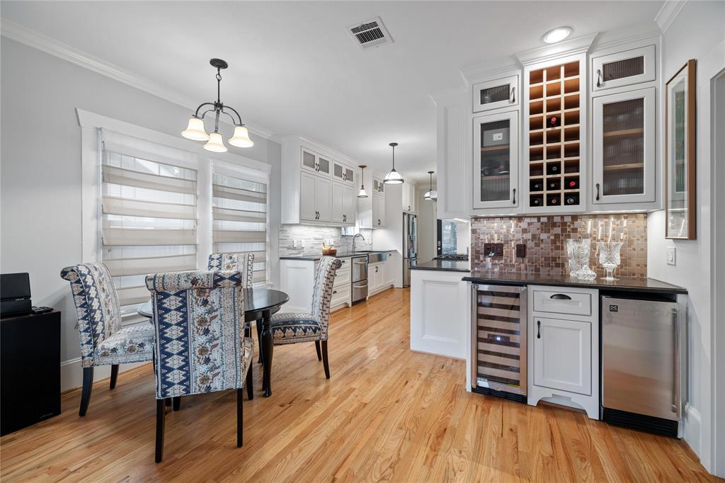 The dining space and bar area feature an ice maker and wine storage.