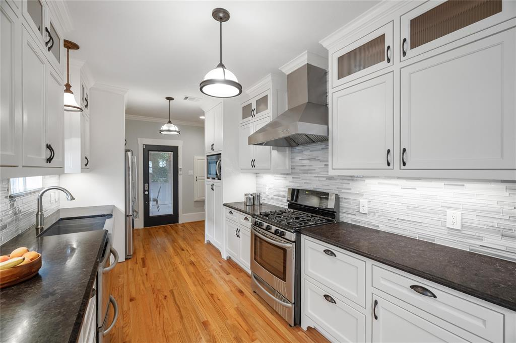 The family chef will love the beautifully updated kitchen that features granite counter tops and stainless steel appliances with double drawer dish washer.
