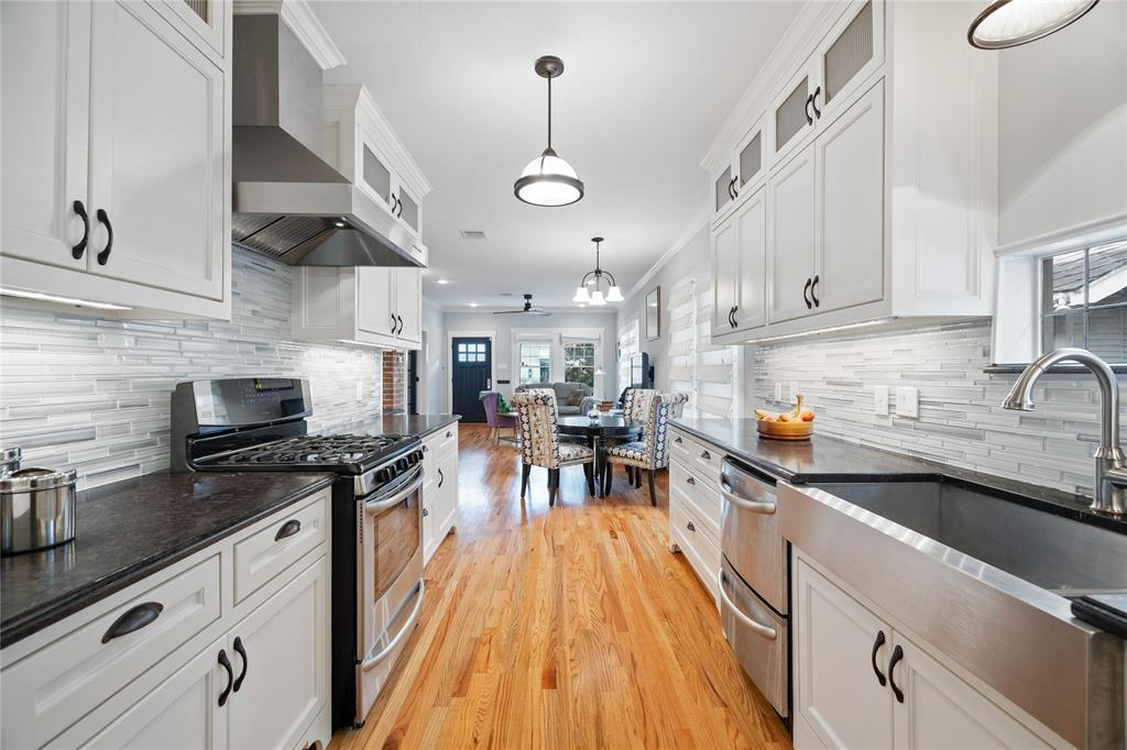 The kitchen has plenty of storage and also features a two compartment, stainless steel sink.