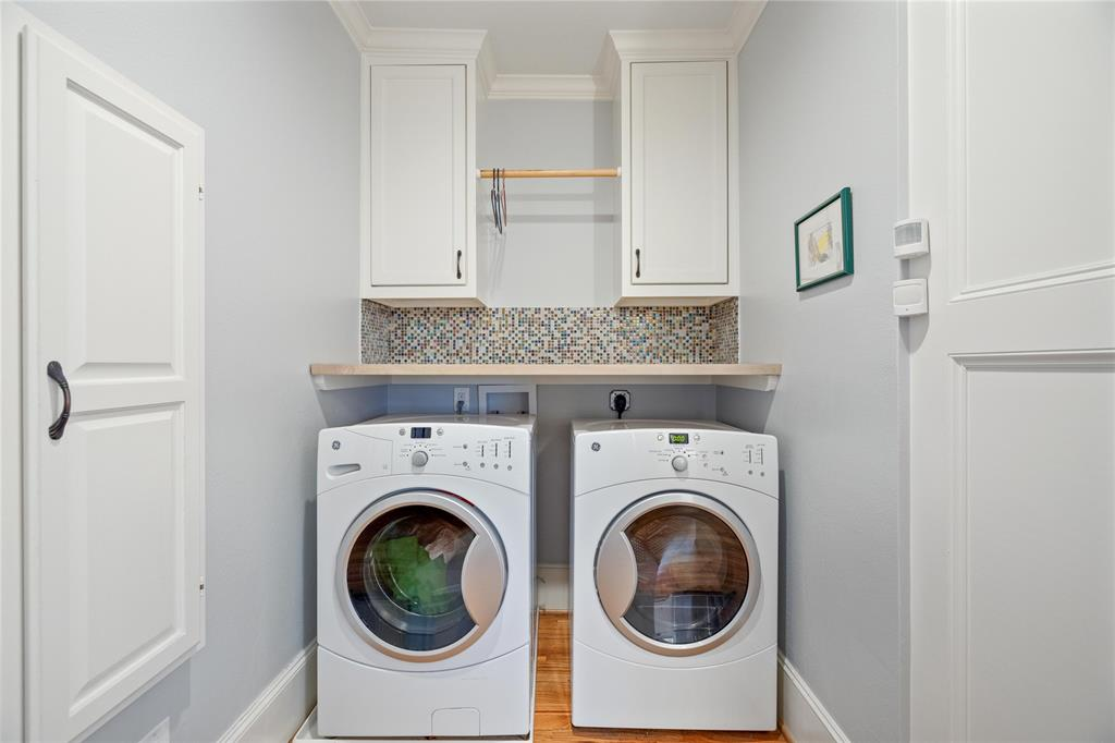 The laundry space inside the home has some additional storage.