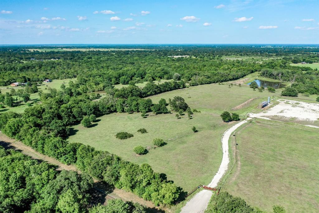 11 +/- Acres with paved road frontage in Madison county is hard to come across. This Tract of land offers 565 Ft Road frontage on Fm 3060. Scattered Oak trees and rolling terrain gives this unique tract lots of character. 10 Miles from Madisonville, 1 Hour from College station, and 1 1/2 hour from Houston.