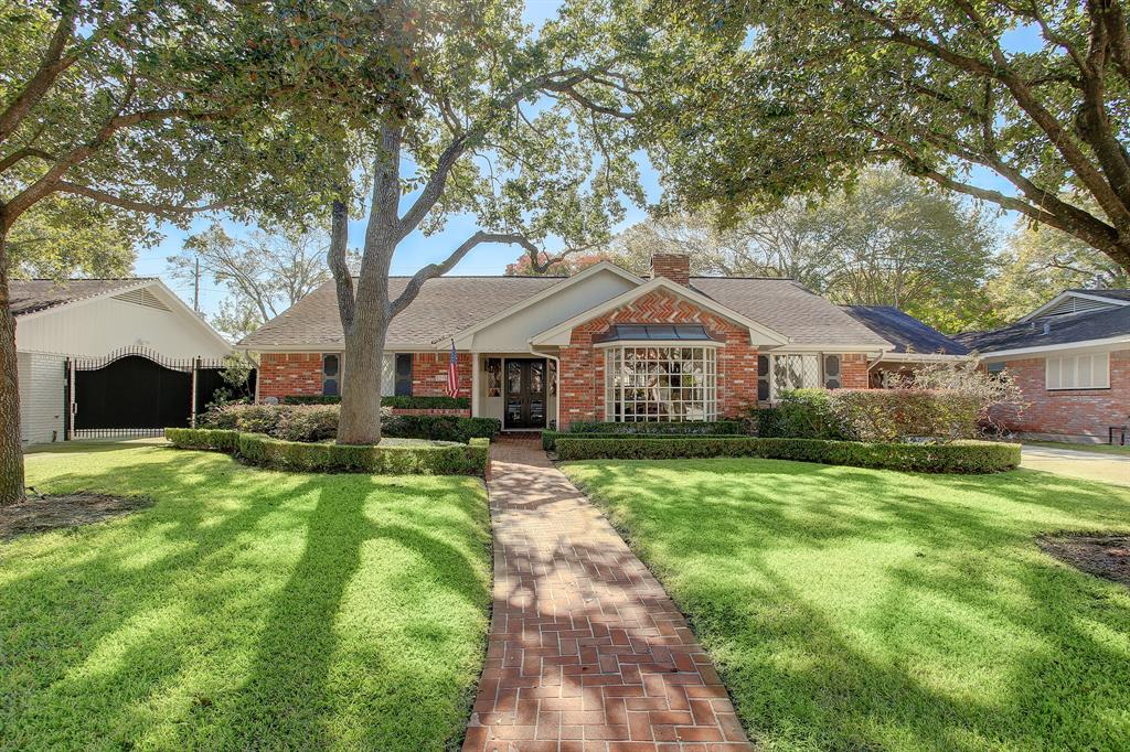 Down at the end of a brick pathway, beneath the shade of oak trees, at the foot of a manicured lawn with tailored gardens is a sprawling, Tanglewood-style home in Briargrove. Freshly painted + refreshed this lovely home features hardwoods, large rooms and a large lot. Off the Entry are the large formals with accent windows. Great Room features wood burning fireplace, coffered ceiling and a wall of built-ins.Updated Kitchen has gas range, oven, quartz counters + abundant storage. Down a long hallway is a one car garage, built-ins, a deep storage closet, and a Game Room with en-suite Bath that could be fifth Bedroom.Master Suite is capacious, private and has a wood burning fireplace, dual Bathrooms + dual Closets--one Bathroom also has a Study within. Secondary Bedrooms are nicely sized with great closet space; two share a hall Bath, and one Bedroom is en-suite. The Back Yard has a covered, brick Patio + grassy play space. This home affords gracious living + all Briargrove has to offer!