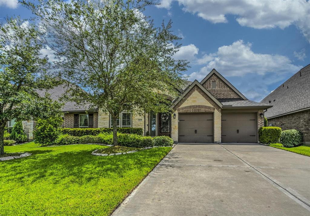 Stunning 1-story Perry home located in the desired subdivision of The Reserve at Brazos Town Center.  This meticulously maintained, beautiful home offers a spacious open concept plan and beautiful kitchen with walk-in pantry, granite counters, 42 in raised panel cabinets, island, stainless steel appliances, and lots of extra cabinets and counter space. The home boasts 12 ft ceilings in the extended entryway, dining room and family room and 10 ft. ceilings in the rest of the home with 8 ft doors throughout. Game room just off the breakfast room, study at the front of the home, mudroom, 4 bedrooms with 3.5 bathrooms, 3 car tandem garage with speckled epoxy coated floor, and 10 zone custom sprinkler system. This home is within walking distance of the pool/playground area, dog park, soccer fields, frisbee golf course, walking trails, shopping and restaurants. This home is a must see; the kitchen will not disappoint.