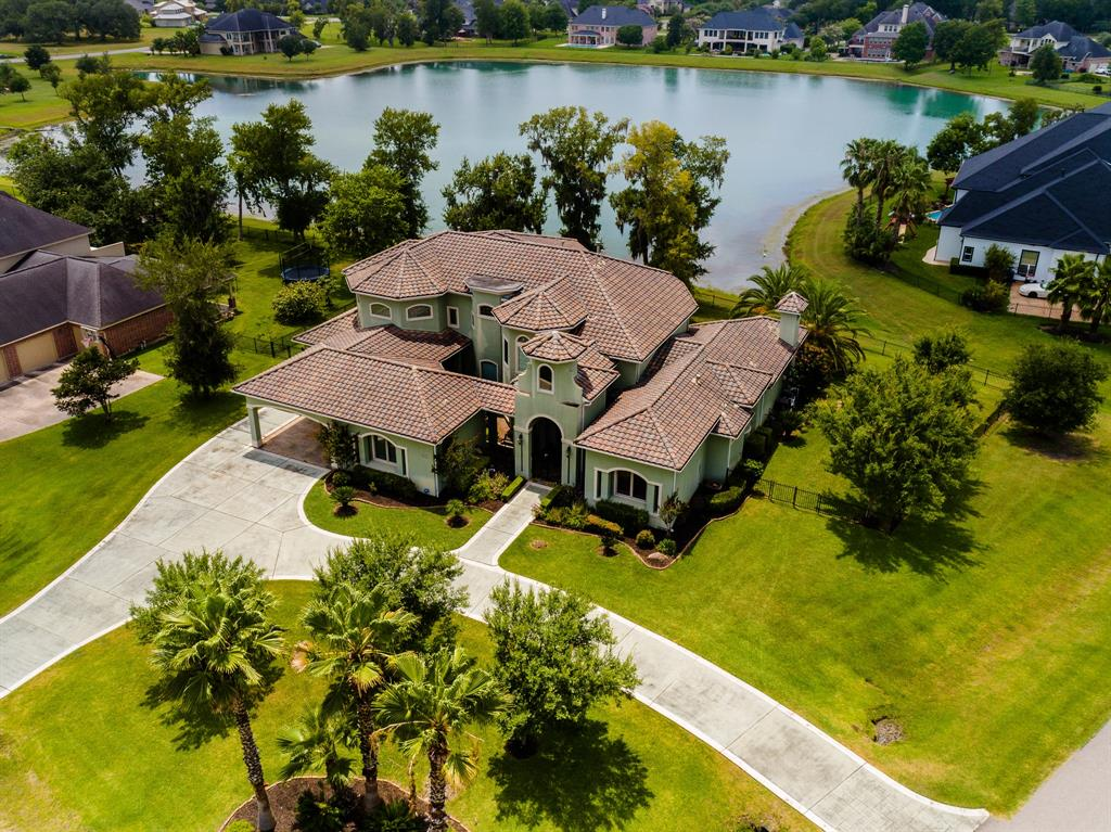 This nearly 5,500 sq. ft. home with guest quarters is sure to impress! ORIGINAL OWNERS have taken painstaking efforts to maintain and improve this residence! With breathtaking lake views, state of the art pool and spa, outdoor kitchen, and much more this backyard is perfect for entertaining!! Kitchen large enough to impress a professional chef and open to Living Room to be included in the fun. Primary bed and bath befitting a King and Queen. Theater Room will knock your socks off as well! Tons of garage and porte cochere space for families with lots of vehicles!! Among other improvements and updates: **$60,000 POOL/SPA/DECKING update in 2017**SUMMER KITCHEN ALSO REPLACED in 2017**New Tile roof installed in 2011**Full sprinkler system** DRIVE BY SHOWINGS ONLY, Interior photos coming soon. Call you Realtor today before this gem is gone!!