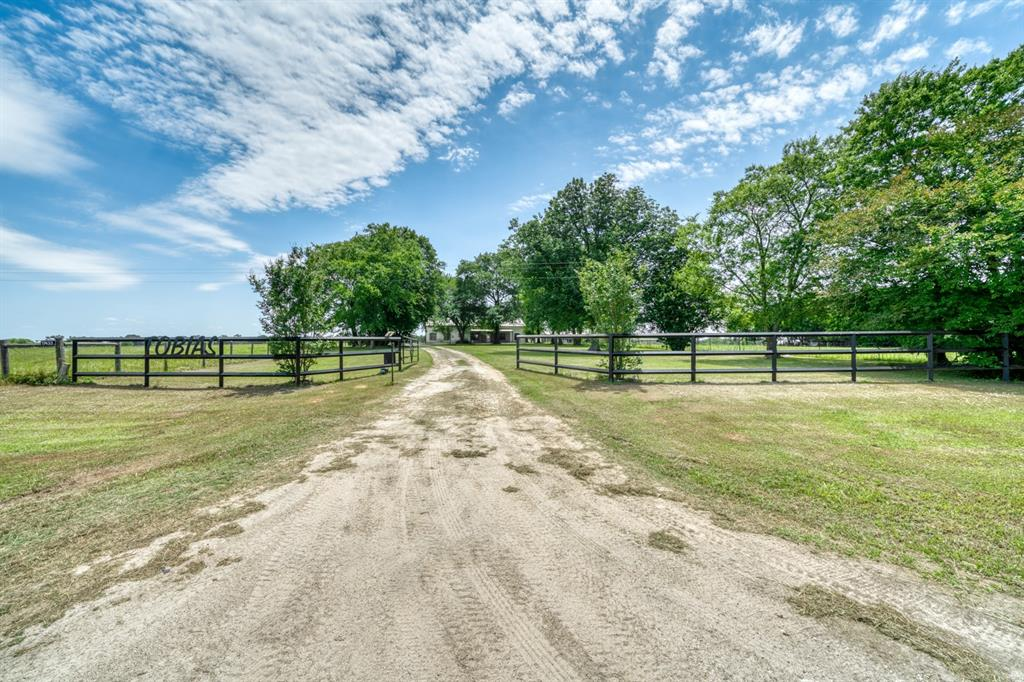 3 bed, 2 1/2 bath 2501 sq ft ranch style home on 33+- acres in Madison County.  Property consist of improved pasture used for cattle grazing, as well as a couple horse traps near the barn.  There is a 2020 sq ft metal barn for equipment storage as well a nice horse barn.  A 20kw propane powered generator for electricity outages will convey with the property.  Property conveniently located minutes from Madisonville, 1 hour from Houston and 45 minutes from College Station.