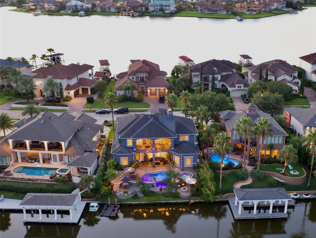 Welcome to waterfront living in the lap of luxury with stunning, resort-style outdoor living space boasting a luxurious swimming pool adorned w/ infinity edge waterfall, sensual hot tub, outdoor shower, relaxing tanning ledge, decorative mosaic tiles, outdoor kitchen, gas fire-pit & extensive lush landscaping! This Mediterranean-style home is quietly nestled in the exclusive gated section of Seabrook Island and speaks serenity & class while endorsing quality & architectural design. Seabrook Island is located in the heart of Taylor Lake just minutes from bay fishing, greater Clear Lake & deep water access to Galveston Bay-a haven for boating enthusiasts. This property offers a convenient commute to Houston, NASA-JSC, leading medical facilities & oil/gas corporations. Modern-living home boasts a desirable, functional floor plan w/ home-office, 2-private primary suites, 4-full baths, game room, media room & spare bedroom on 1st floor. No flooding during Harvey; see pictures descriptions!