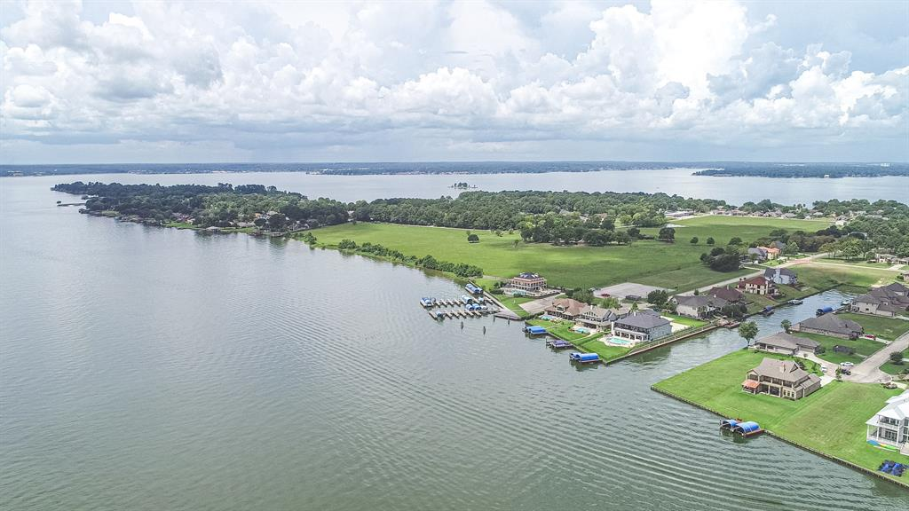 FEEL LIKE YOU ARE ON VACATION EVERY DAY on this WATERFRONT LOT on LAKE CONROE! This is a GREAT PRICE that will allow you plenty of budget for your new custom home! This is a great opportunity to own property right on Lake Conroe where you can walk out your back door and be on the lake in seconds. These short canals are wide, and have quick access to WIDE OPEN WATER. You will love this upscale community called The French Quarter on Lake Conroe. It is a beautiful gated neighborhood with a club house, pool, gazebo, marina, boat slips and boat launch. It's close to I-45 for quick access to the freeway and a quicker commute to Houston, The Woodlands, IAH, and Conroe. Get away from it all, but still be close to it all, and come build your dream home on this spacious waterfront lot.