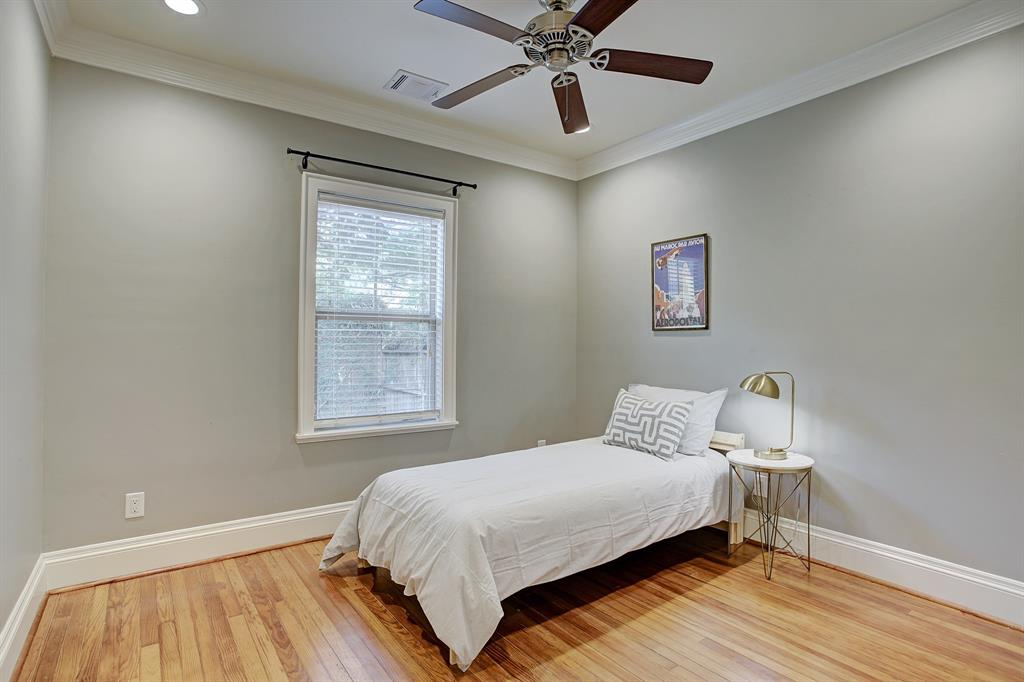 The first secondary bedroom is at the back of the home overlooking the yard, and has a nicely sized, organized closet.  This is a twin bed though the room can readily accommodate a queen bed, dresser and more substantial side tables.