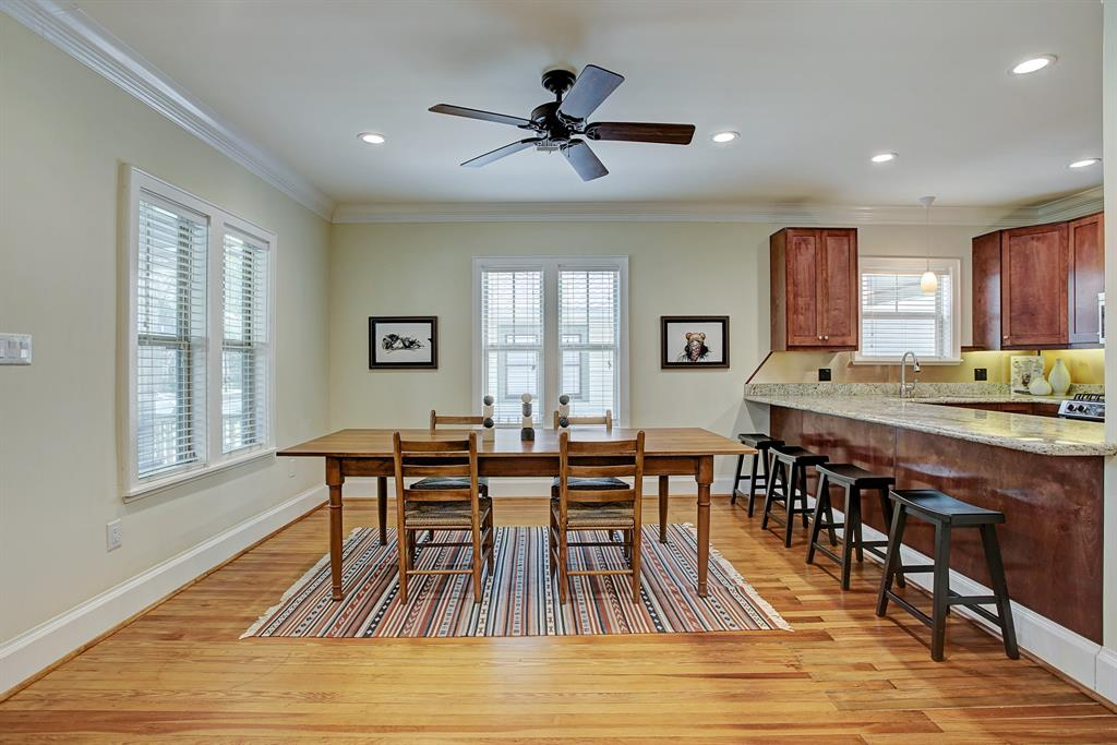 The living/dining space is wide with room for amply sized furniture.  This is comfortably an eight person dining table.