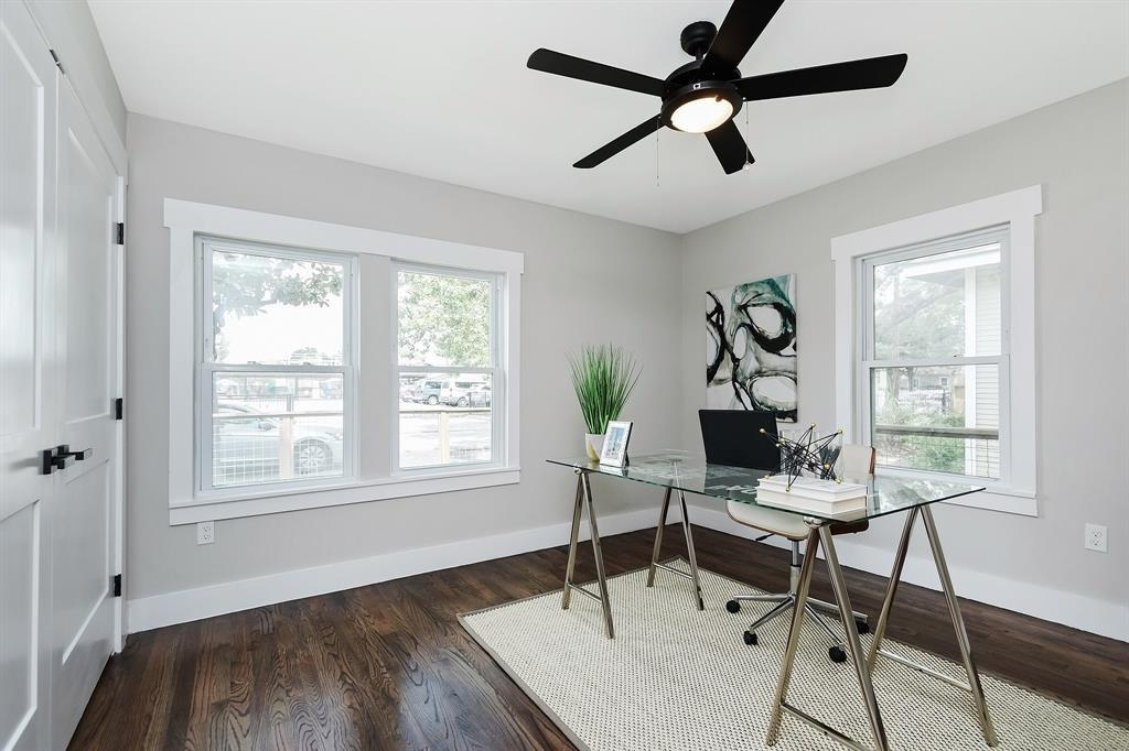 The front/second bedroom works equally well as an office space, looking out onto the front yard and Alexander St.