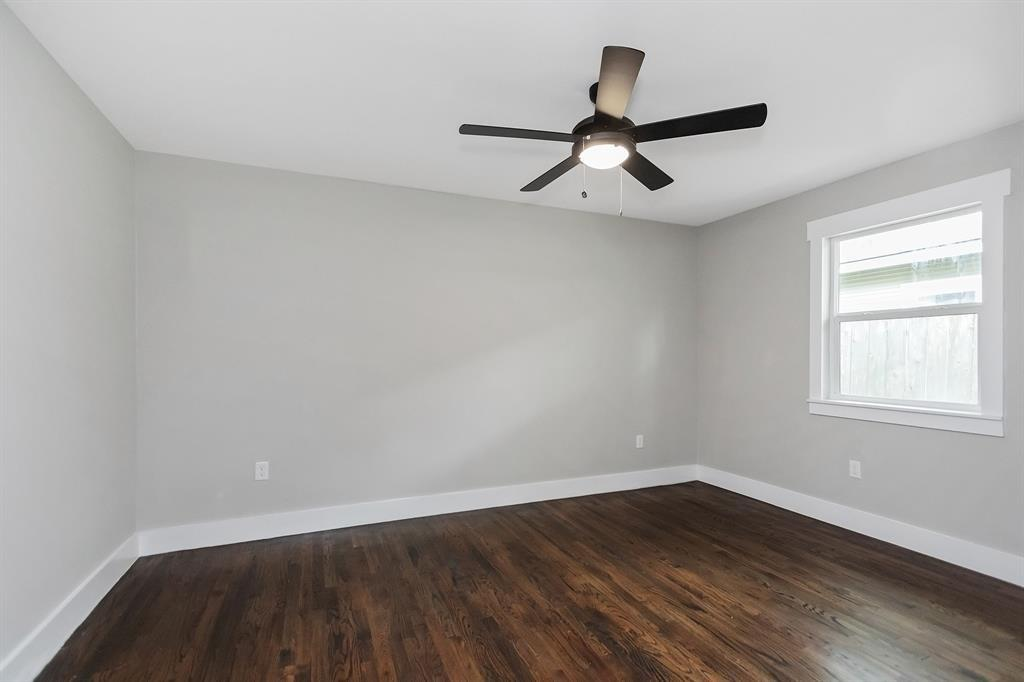 The fourth bedroom is across from the kitchen in the middle of the home.