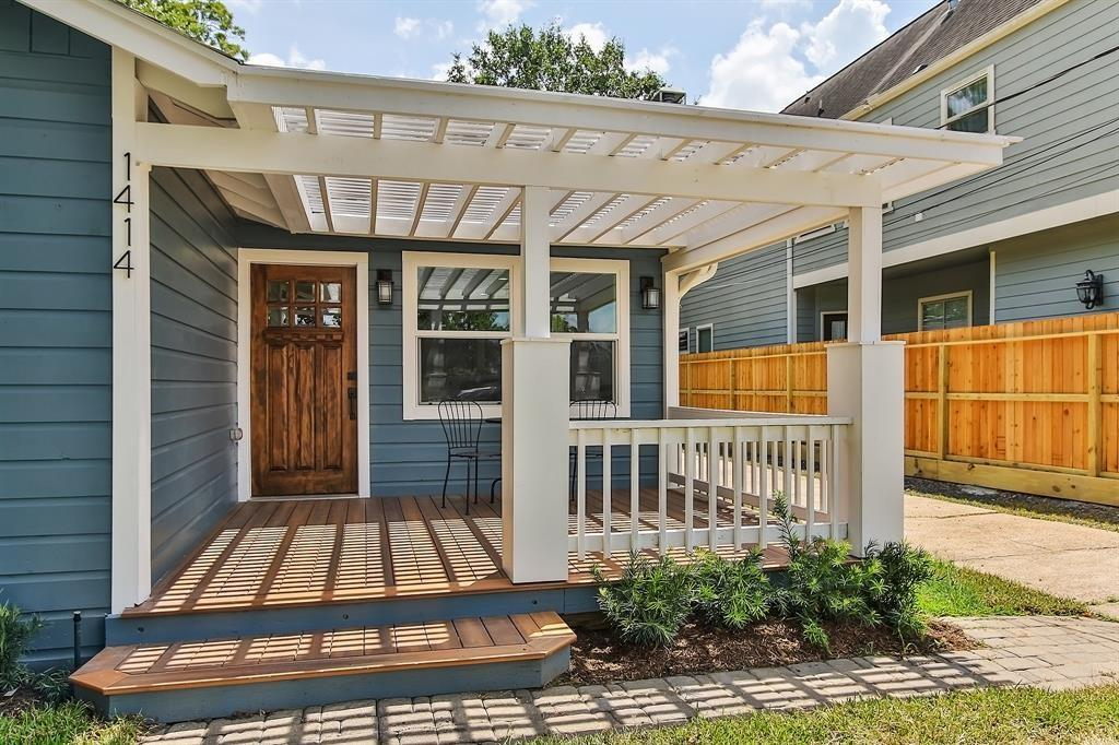 This lovely front porch is well sized to accommodate comfy furniture and provide a serene spot to relax.