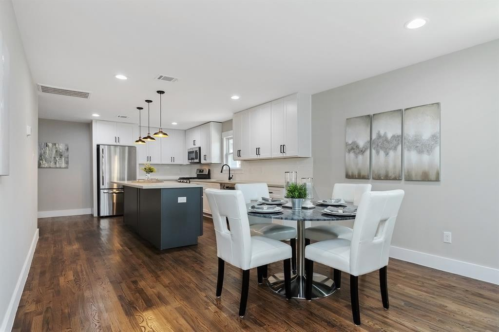 A closer look at the dining area and two toned kitchen.