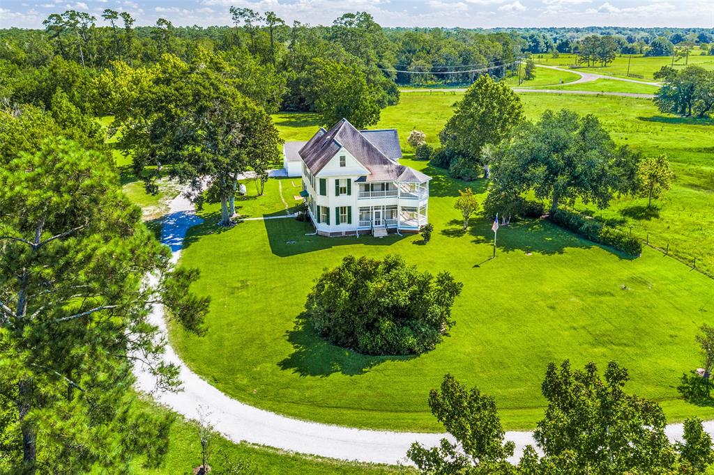 This exquisite Victorian home of John Claude Jackson, built in 1901, is located in Double Bayou, Chambers County, 10-miles south of I-10. 40-fenced and gated acres. (Adjacent 42-acres w/bayou frontage is also available for sale).  The estate is meticulously maintained. Original features include carved, hardwood entry doors w/stained glass; high ceilings; pocket doors; walk through windows; sash windows with transoms; wrap around screened verandas w/Victorian spindles; gas log fireplace encased in marble; original hardwood floors; and ornate staircase with a second floor landing and third floor attic.  10-Inch baseboards, distinctive door casings, and crown molding throughout.  Aerobic septic system and MUD for water.  2-car detached garage with large utility area and extra space for workshop or office.  Barn with additional parking for equipment. Don't miss the opportunity to own a piece of Chambers County History.  A beautiful sanctuary for the Heart. Mind. and Soul.