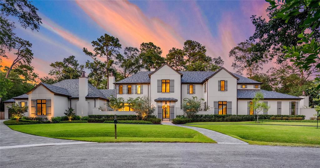 "Set upon nearly an acre in Hunters Creek Village, this expansive 8,588 sf home was designed by the lauded architectural firm, Mirador, which carefully calculated every detail of this 6-bed/7.2-bath manse. Built for those who adore cooking & entertaining - a dream kitchen featuring double marble islands & 48"" La Cornue gas range + service kitchen, butler's bar, wine vault & loggia with outdoor kitchen. Formal dining with dual-sided fireplace opens to living with 12' ceiling inspired by an ancient cathedral in Prague. 1st floor owner's retreat with Moorish-inspired relief rendered upon the ceiling, exercise room/office & private courtyard with fireplace. The adjoining bath is a lavish sanctuary accented with marble, Roman shower, soaking tub & generous closets (3). Upstairs, 4 en suite bedrooms & game room wired for your state-of-the-art electronics. Amenities abound w/ guest suite down, elevator, mudroom, 2 laundry rooms & pet spa. The owner of this stately home will want for nothing!"