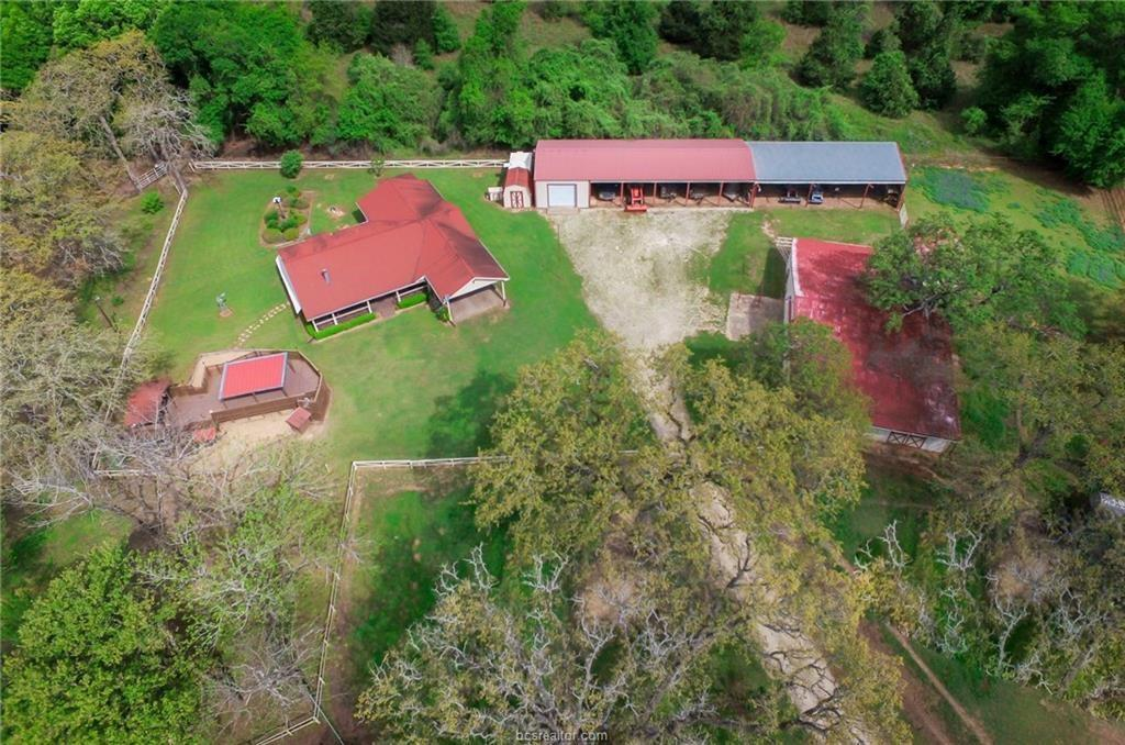 Enjoy over 80 acres sprawling across Burleson & Lee County while sitting on your front porch watching the sun set against the multiple elevations, eagles in the sky while listening to the stream of water from the creek flowing. This property has so much to offer from being at the end of a county road with a grand entrance, perimeter barb wire fencing, cross fencing, AG exemption, bridges to cross the creek, horse stables,8 bay stalls for farm equipment,pens,storage sheds,workshop,sprinkler system,gazebo and a 4 bedroom ranch home with wrap around porch and attached carport. Currently being grazed on by horses. USDA tested soil and said no fertilization for grass because of the creek.