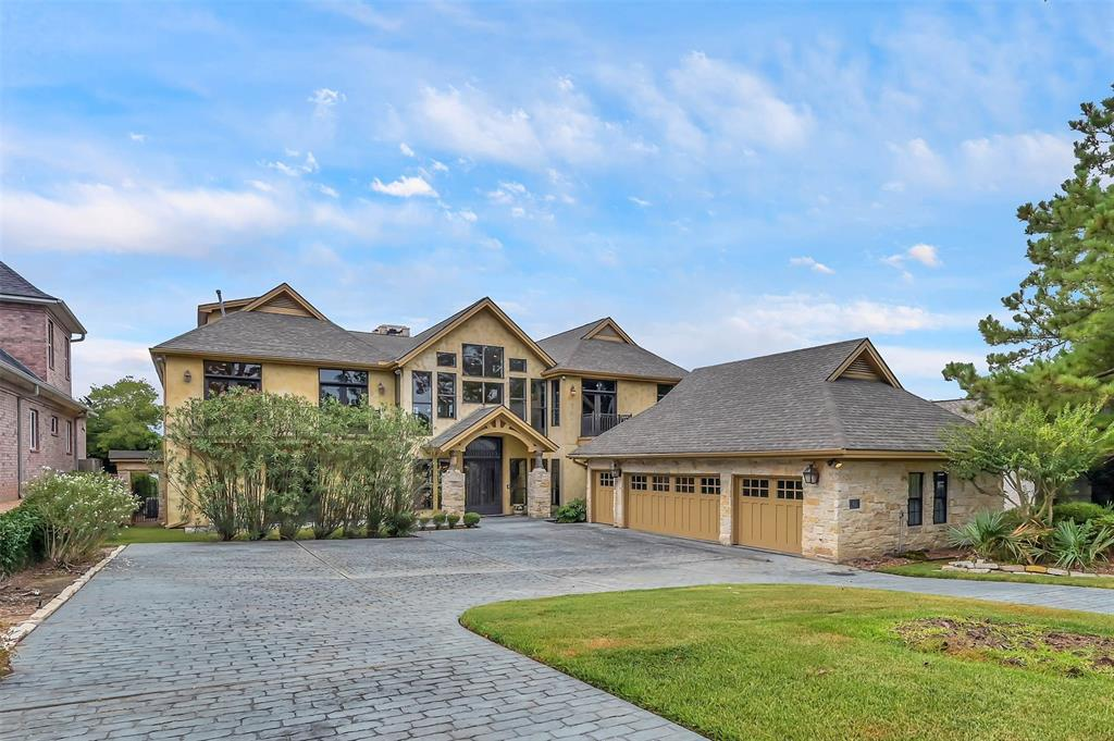 Welcome to this beyond stunning CUSTOM waterfront home in Bentwater on Lake Conroe! This home is filled with natural light and lake/golf course views galore! VERY large closets in each room, including a 2-Story closet in the over-sided owner's quarters! Gourmet kitchen & butler's pantry ready for any type of culinary works or dinner party! Want to relax and unwind? The look no further than the den that comes equipped with bar, ice maker, & wine cooler! This home also comes with two boat slips, a boat lift, and jet-ski lift. Grand Pines level Country Club Membership is available with this home! Lake fun is always right out your back door.