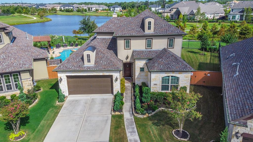Beautiful custom home located on an oversized premier lakeview lot offering serene views of wildlife. Located in a small, private neighborhood of Aliana, The Lagos is just steps away from the Aliana Fitness Center, pool & tennis courts. This open & bright floorplan offers a grand living area with 14' ceilings, a private study,  3 en-suite bedrooms and lake views from most rooms.   The gourmet kitchen showcases a large island serving bar, custom painted cabinets w/easy close doors & pull out storage, exotic granite counters and gas cooktop. Beautiful hardwood floors extend throughout the living spaces. The luxurious master suite has a wall of windows overlooking the lake and a luxurious bath. The downstairs guest room is en-suite as is the upstairs flex space.  A screened in porch w/ custom flooring & fireplace allows for beautiful views & year round enjoyment. Custom landscaping, water softener, sprinkler & security systems  PLEASE SEE A COMPLETE LIST OF AMENITIES IN ATTACHENTS.