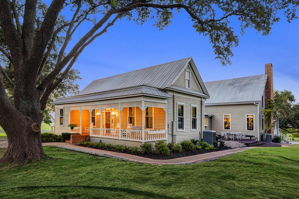 Approx. 89+ acres situated on a magnificent hilltop in the Prairie Hill Community of Washington County (Brenham - Independence). Entry drive is highlighted by a mature live oak tree canopy that  leads up to the estate grounds where there are breath-taking panoramic views offering colorful sunrises & sunsets. Completely restored and renovated farmhouse with attention given to every detail. 4 bedrooms, 4 baths, spacious great room, formal dining & living area and large mud room. Immaculate landscaping, sprinkler system and numerous shaded porches/decks. 2/1 guest house, garage, office/garden shed, large metal barn (great for a car collector, entertaining or horses), swimming pool with large deck and manicured yard with Live Oak & Pecan trees overlooking 2 ponds and ±5.25 acre lake w/ floating pier & covered dock. Located only 30 miles to College Station and just 8 miles to downtown Brenham.  This remarkable property was featured in March 2020 issue of  Southern Living Magazine.