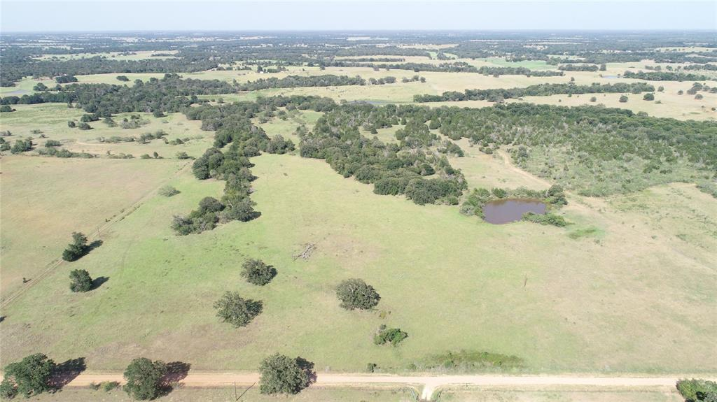 Ideal place to hunt, fish, run livestock, & for a homestead. Fully fenced w/1 large pond & seasonal creek. Has deer, feral hogs to come hunt, plus doves, ducks! Improved pasture grazing for cattle/horses. Mixture of hardwoods, mesquite, cedar & small brush to support wildlife. Additional water sites. Elec. on property & coop water close by. 2 gate entrances w/CR frontage near the end of dead end road. Short drive to Lexington or Giddings, and one hour to Austin. Portable pens, mineral & deer feeders, deer stands are negotiable.
