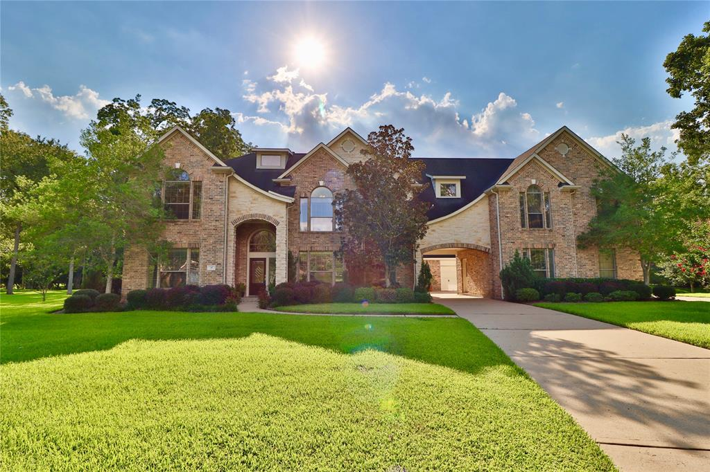 Spectacular 7 bedrm custom home with grand two story entry with granite medallion and a  wrought iron dbl staircase. Situated in a cul-de-sac on over an acre lot with mature trees. The dining rm is accented with crown molding and rope lighting and a wine closet. The two story living room has large windows natural light and has a double sided stone cast gas fireplace. The kit/family rm is an open concept allowing the host to be part of all the activities. A 2nd bedrm with an en-suite is down stairs which has a view of the lake and fountain.Guest quarters with full bath on 1st fl on the porte co-chere. This could easily be changed to an exercise room. The spacious master has a view of the lovely backyard along with a sitting area and fireplace. Any family will love the media rm with beautiful wood molding and sconce lighting. The projector and the subwoofer speakers are included. The extra large upstairs bedroom could be a second master if needed.  Golf course community.