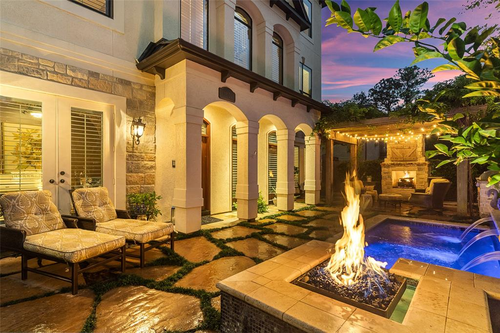 Luxury Living with low maintenance! Timeless & Elegant 3 story Single-Family Home located in an impressive gated enclave in the heart of Briargrove/Tanglewood area. Freshly repainted.  Along with a unique open Elevator, this home features a Pool/Spa w/Fire Pit, wisteria-covered Pergola, Outdoor Kitchen & Fireplace perfect for entertaining. First floor features a Formal living room with brick ceiling, large study/den, and large bedroom w/ en-suite bath. Second floor is an open kitchen, dining room, sunken family room w/ fireplace, oversized bar w/wine chiller & balcony. The Third floor features the master bedroom, master bath w/ two closets & balcony, along with a secondary bedroom w/ en-suite bath. Some automated lighting and thermostat controls with Control4 system and 3 cameras. This home is full of stunning features, don't miss out. Priced to sell.