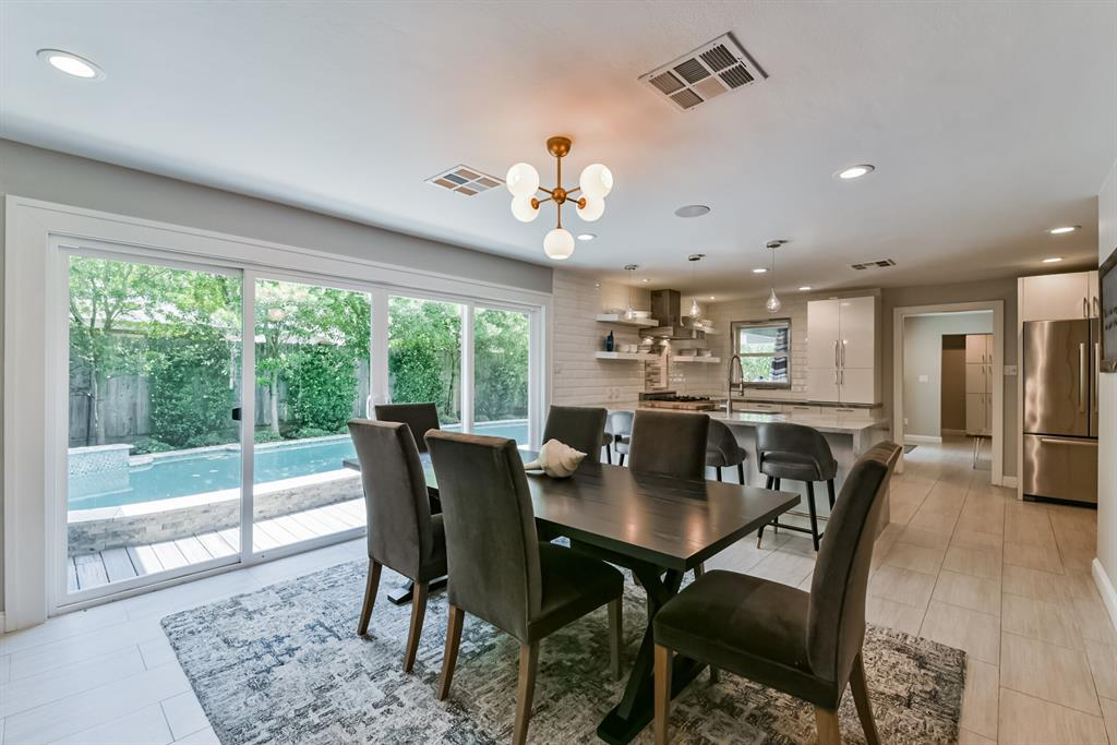 Beautifully remodeled modern ranch style home zoned to prestigious schools in desirable Timber Creek neighborhood.  This 4 bedroom home features hardwood & tile floors, abundant storage, a chef's dream kitchen with ss appliances, gas range, views overlooking backyard, spa like master bathroom, downstairs playroom/den and a family living room, an extra multi purpose room on the second floor with balcony that over looks the pool, outdoor kitchen...easy flowing floor plan and manicured backyard  is perfect for entertaining and/or relaxing.  Easy access to I-10, Energy Corridor, Downtown, medical, shopping, restaurants and much more!  Don't miss out on this opportunity!