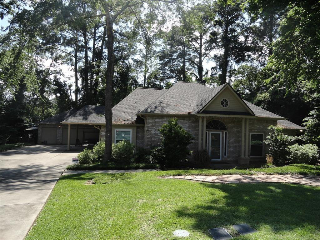 This single story home on 2 wooded private park-like lots featuring an open floor plan with 4 beds and 2.5 baths. Tons of storage throughout the home. Granite counter tops in the kitchen. Tile in all living areas, and carpet in the bedrooms. Huge deck in backyard and a large enclosed patio. This home is situated is a gated community with active patrols, on a large wooded lot, in a cul-de-sac, off all major roads. Located in April Sound Community with pool area, 3 golf courses, Indoor and Outdoor Tennis courts, workout facilities, and dining all in the neighborhood. You can take advantage of all the amenities by joining the Club.