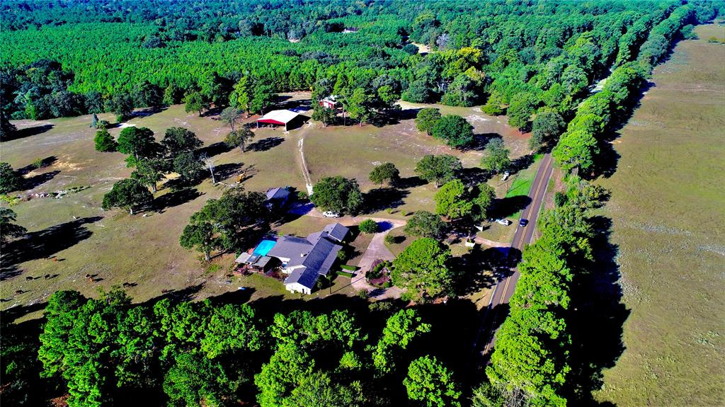 This sprawling 4/3 home sits atop a hill on 60 beautiful acres. This home has a large living area with a unique brick accent wall and fireplace. Pretty French doors lead you to an awesome game room with a wet bar. The large island kitchen is made for the cook in the family with custom oak cabinets, granite countertops, stainless appliances, and tile backsplash. The master suite is fit for a king with a huge walk-in closet and private bath with his and her sinks, large soaking tub, and separate shower. One of the three guest bedrooms could be used as a second master suite. All guest bedrooms have great closet space and share a large bath with a vanity area, separate tub, and shower. Outdoors, you'll fall in love with the beautiful patio areas, 6' inground swimming pool, fireplace, and fenced backyard. There is an attached 2-car garage, separate 3-car garage, large hay/equipment barn, large shop/barn with a rollup door, and several other storage facilities. Addtl land available.