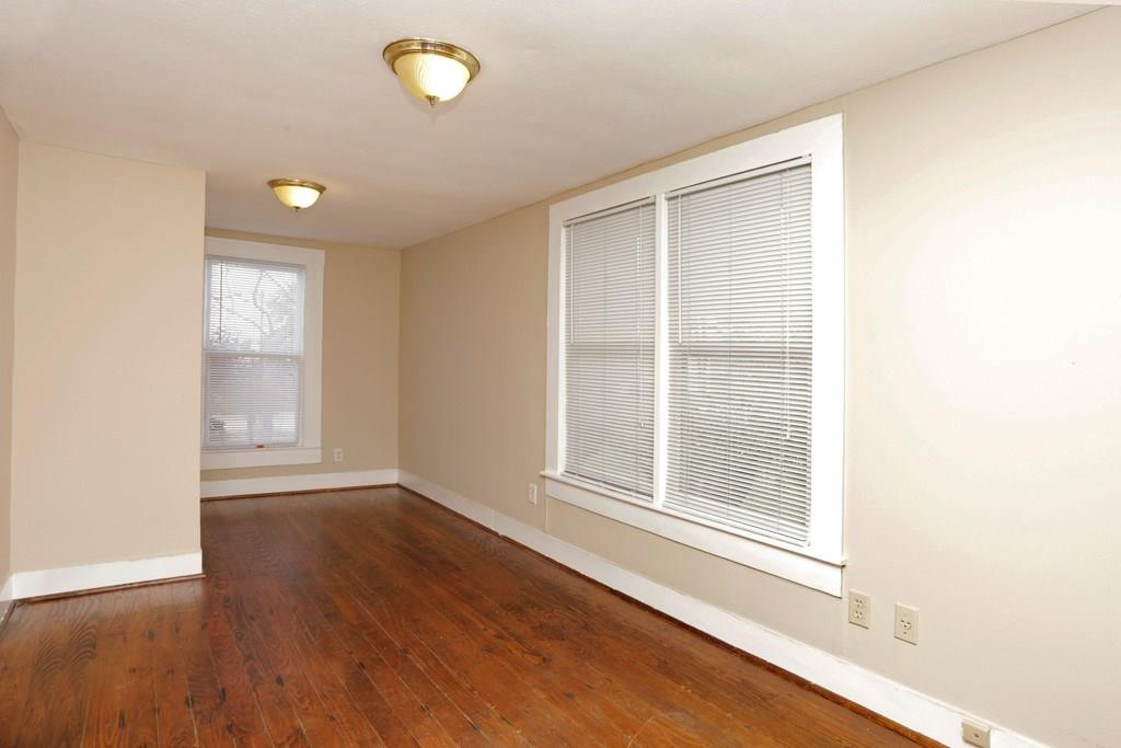 This study/den is perfect for a home office set up, looking out on 21st St. and Lawrence St. In the past it has also been utilized as a big walk-in closet for the primary bedroom.