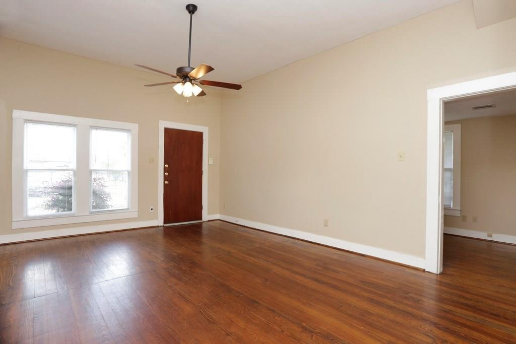 The entry to this property takes you to a spacious living room. The door to the right leads to the 17 x 7 study/den, with access to one of the bathrooms.