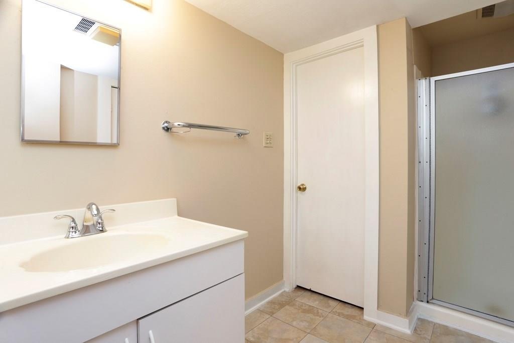 This is the full bathroom which sits between the primary bedroom and study/den.