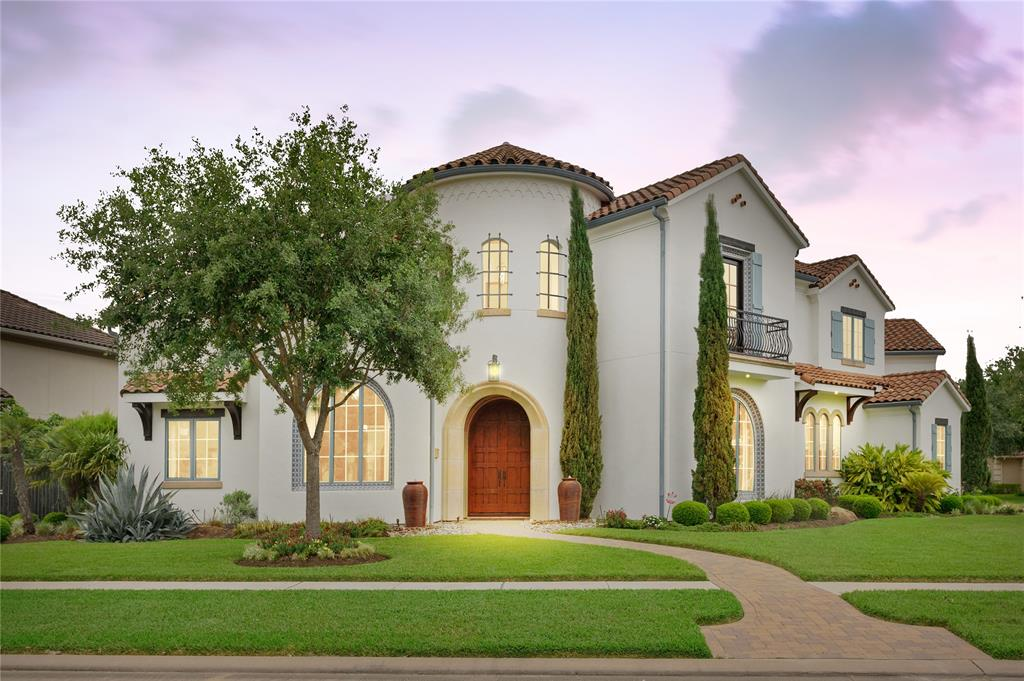 In the luxurious lake centered and gated community of Hartford Landing at Riverstone sits one of Sugar Land's most exceptional properties. Built by Sims Luxury Builders, this home is situated on an expansive corner lot with arched windows, terracotta roof and beautiful white stucco. The incredible backyard features an extensive veranda, outdoor kitchen, dining and lounge area, fireplace, pool, and spa. Other features include wine grotto with separate wine chiller, living area with coffered ceiling, fireplace and 3 sets of French doors leading out to the veranda, study, game room, theater, balcony, flex room currently used as a fitness room, home speaker system, decked attic spaces for ample storage and central vacuum. The gourmet kitchen boasts custom cabinetry, Wolf gas range, Sub Zero fridge, separate ice maker, and farmhouse sink. The primary suite will be your private sanctuary with a fireplace, his/her water closets, double vanities, freestanding tub, and spa-like shower.