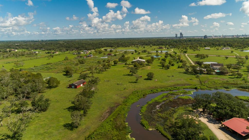Beautiful 10 acres on Jones Creek located in Freeport. There is a barn, water well, septic and electric already on this property. 1350 feet of creek frontage across the creek is Live Oak RV park. Property is fenced and crossed fenced with AG exemption. There are 2 adjoining 10 acre tracts that are also available. Gorgeous live oak tree clusters around the property to provide shade for all your livestock.