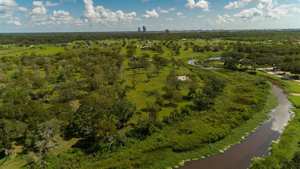 Beautiful 10 acres on Jones Creek located in Freeport that has electric already on this property. This property is fenced on 3 sides, with Ag exemption. There are 10 adjoining acres to the left that is available. Gorgeous live oak tree clusters around the property to provide shade for all your livestock.  Bring your cows, pigs and horses and make this your new home.