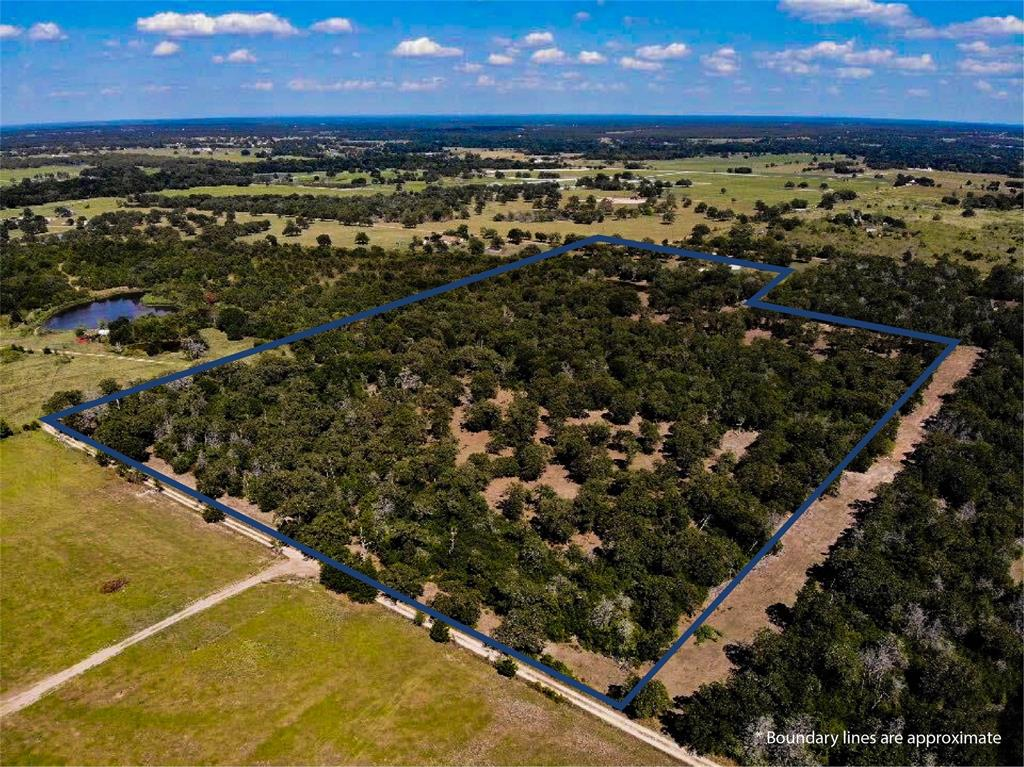 Located off a private road, this heavily-wooded, 26.935-acre property is just a short drive outside the Giddings city limits. Perimeter fencing, available electricity, a large pond, and an Ag exemption provide solid starting points for making this place your own.