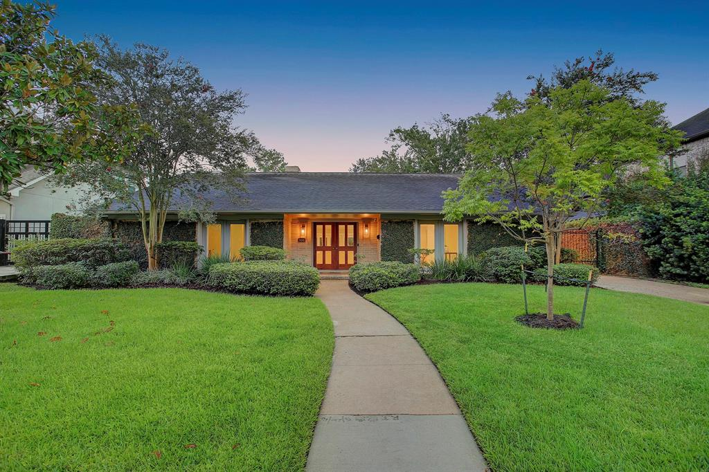 Mid-century one story ideally located in the Inverness neighborhood in Hunters Creek Village. Glass paned front doors open to step-down living room with fireplace. Living area has floor to ceiling windows and doors with access to the backyard which features a resort style pool with waterfall and hot tub plus gas lit firepit. Open concept floor plan flows into the kitchen and breakfast room which can also serve as the main dining area. 3 bedrooms plus a study. Additional room with full bath is adjacent to 2-car garage. The kitchen has double JennAir ovens and a 4-burner cooktop with grill, and KitchenAid dishwasher and wine refrigerator. Primary bedroom has a walk-in closet and bath with double vanities, spa tub and separate shower. Terrazzo floors throughout the living areas, study, and kitchen. Covered patio off the living room also connects to the garage. Utility room has laundry sink and half bath. Driveway with automatic gate. Zoned to Hunters Creek Elementary and Memorial High.