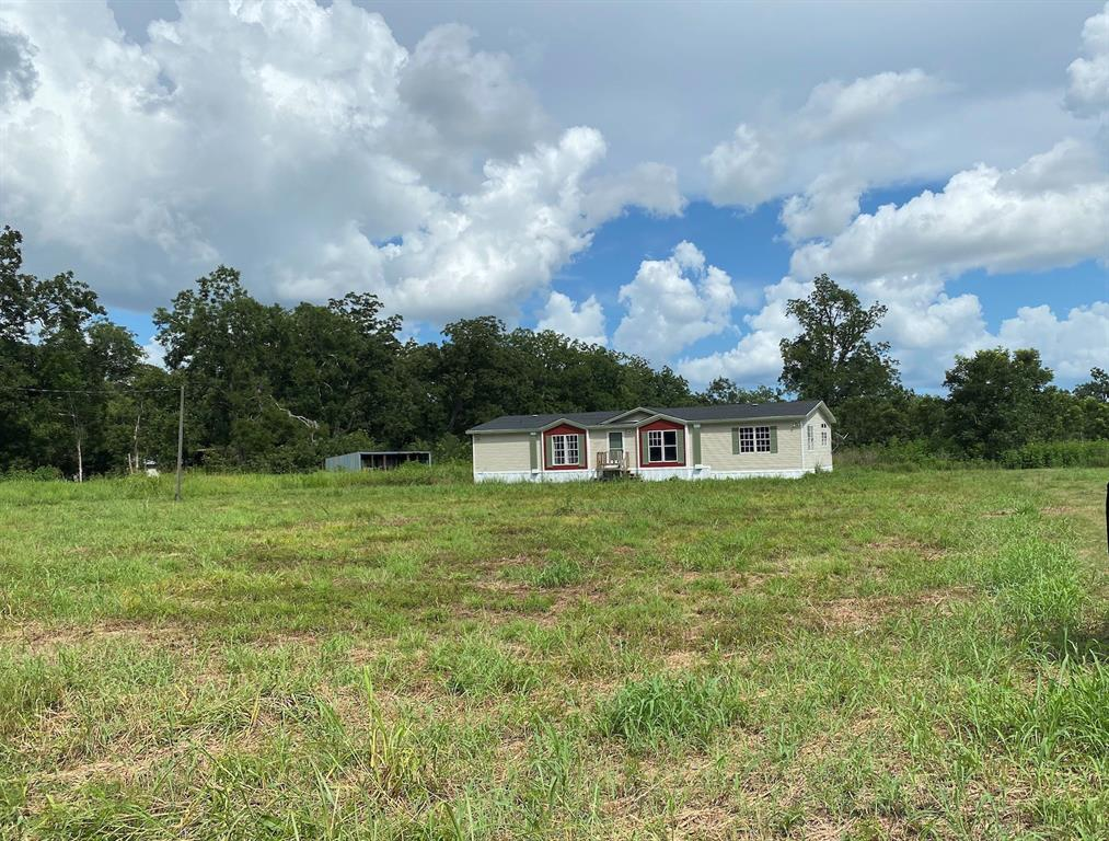 10+/- Acres with completely remodeled doublewide mobile home ready for move in!  This home has recent paint, carpet, appliances, cabinets and so much more!  Currently has an aerobic septic, well, Shed row barn, and fencing (some needs repair which belongs to neighbor).  This property is zoned to Boling ISD and would make a great place for anyone looking for land for their 4H/FFA projects, horses, cattle, etc.