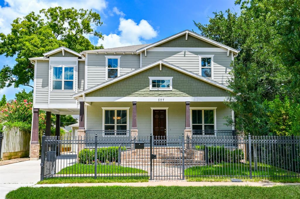 Prime location in The Heights.  Custom built Craftsman style home is ready for move-in.  Home is near Halbert Park.  Completely fenced with power driveway gate.  Welcoming front porch is the perfect place to socially distance from your neighbors.  Enter home's formal entry.  Beautiful hardwood oak flooring throughout.  Formal dining has a view of fenced front yard.  There is also a study that can be used as a bedroom w/ full bath en suite.  Proceed down hall to the family area, kitchen and covered back porch.  Family area has a fireplace, bookcases and additional storage.  Kitchen w/ butler's pantry, large walk-in pantry, and island w/gorgeous marble top.  Lots of cabinetry.  Oak flooring throughout 2nd floor bedrooms.  Primary bedroom is spacious.  Primary bath w/water closet and huge closet.  Another bedroom w/ensuite bath and the other 2 utilize hall bath w/dbl sinks.  Hi ceilings throughout.  Porte cochere over driveway to detached 2 car garage.