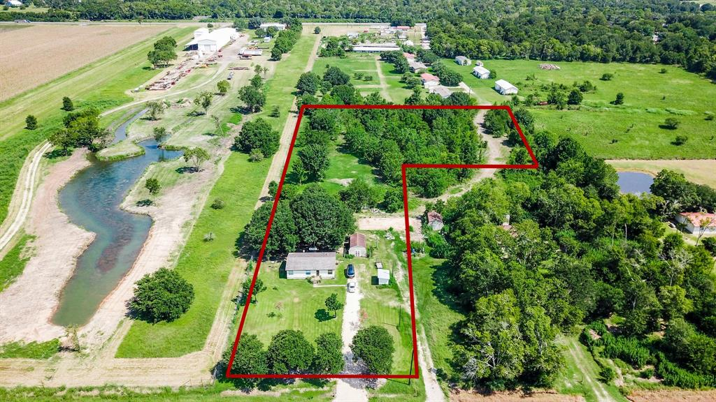 A little over 3 acres with a brand-new driveway (2020)!  Located minutes from both East Bernard and Rosenberg, you can live in a  country setting with city conveniences close by.  Mobile home currently on the property needs some TLC but can definitely be made to shine!  Or you can build your dream home and have space for some animals too!  Property is also set up for a second home with a shared septic and separate electric pole.