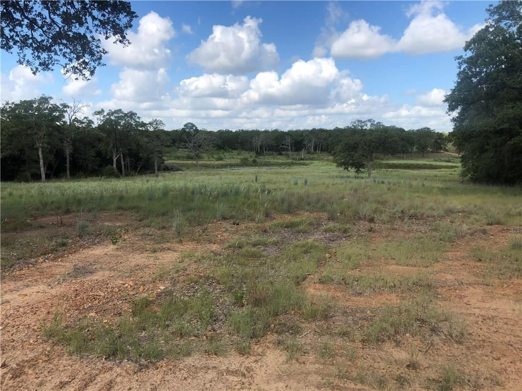 Wonderful large tract in Bastrop county has it all. Excellent frontage, divided into 4 tracts. 1.5 hours to Houston or Austin. Large hardwoods & clearings. trails throughout for exploring & game watching. Great getaway or choose from many stunning sites for a home with a view. 4 ponds. Rolling terrain, nice hill to survey forest, meadows, ponds and large adjoining ranches. Existing septic,well & electric at the property line. Excellent perimeter fence which is cleared for diving most of the boundary.