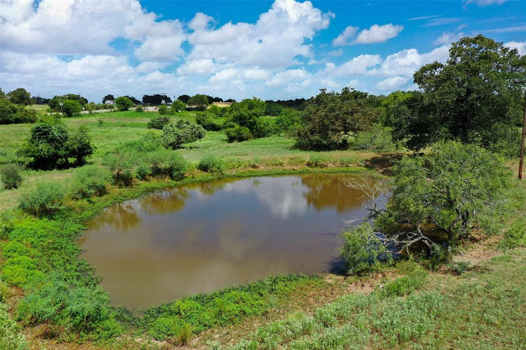 Located on Hwy 77, this rolling, 20-acre property is just a short drive outside the Giddings city limits. Partial perimeter fencing, available electricity, a large pond, and an Ag exemption provide solid starting points for making this place your own.